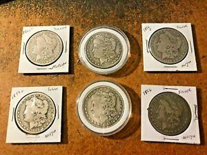 Lot of six silver Morgan dollars