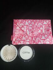 Ipsy bag with Ofra pressed powder and highlighter