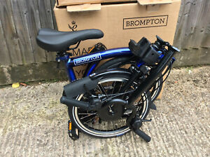 BROMPTON M6L ELECTRIC BOLT BLUE FOLDING BICYCLE - NEW - 2021 - WORLDWIDE POSTAGE