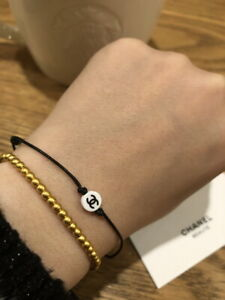 ** Leather String Bracelet with Tiny Logo Charm Vip Gift from Beauty Counter