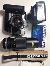 Olympus OM-2 with 50mm F1.4/ 100-200mm / T33 Flash/ Strap/ Winder.