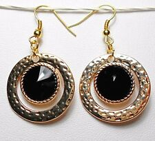 Dangle earrings - gold colour with black faceted glass centre