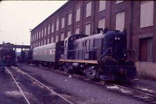CNJ-Jersey Central RS3-# 1548 with BN coach @ Elizabethport NJ 1974-Kodak slide