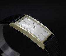 New Old Stock 60s Dress UNIVERSAL GENEVE solid 18K gold CURVEX NOS watch CAL 42