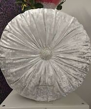 New white crushed velvet round cushion with centre diamonte to centre