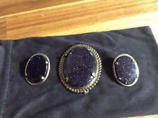 Vintage silver tone set of brooch and earrings with large purple rhinestones