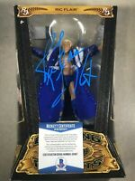 WWE  WCW RIC FLAIR  Signed DEFINING MOMENTS Action Figure BECKETT S51817
