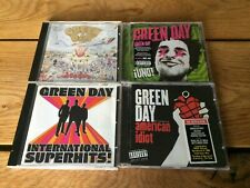 4 GREEN DAY CD ALBUMS  International Super Hits , Uno! , American Idiot, Dookie