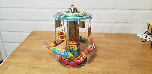"TIN TOY ""RIDE A ROCKET"" SPINNING CAROUSEL"