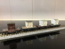 4 x N gauge peco conflat wagons with White containers (white metal )