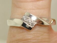 NEW 10K SOLID WHITE GOLD APPROX. 1/6 CTW SPARKLING DIAMOND RING!