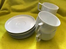 Arzberg 4 Cups and 5 Saucers in White