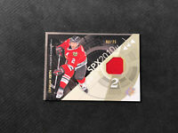 2010-11 UPPER DECK SPX DUNCAN KEITH GAME-USED JERSEY SPECTRUM #ed 8/25
