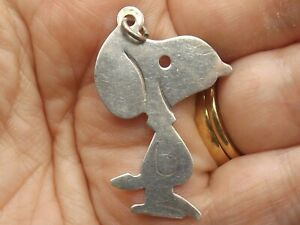 Sterling silver pendant in the shape of Snoopy the dog from Peanuts