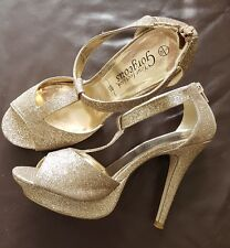 Ladies size 7 gold glittery George Party sandals. Very stylish. Good Condition