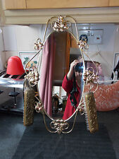 Vintage 1970s oval brass frame hall mirror with flower pattern and 2 clothes  br