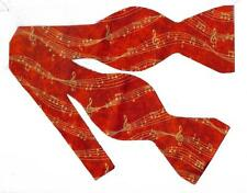 (1) BOW TIE- HOLIDAY MUSIC - FLOWING METALLIC GOLD SHEET MUSIC ON TEXTURED RED