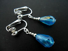 A PAIR OF SHORT BLUE GLASS   CRYSTAL TEARDROP CLIP ON EARRINGS. NEW.