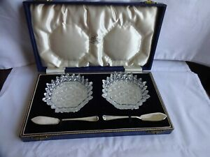 VINTAGE CASED PAIR OF STAR CUT BUTTER DISHES WITH SILVER KNIVES 1963