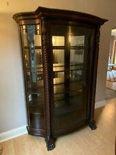 Antique mahogany mirrored curio cabinet