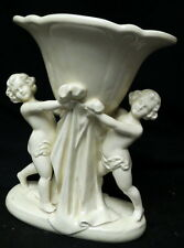unknown signature / 1928 figural nude children holding vase or fruit bowl Rare