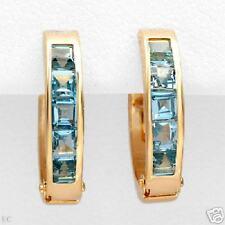 14 k solid Gold 1.20 ctw Genuine Topaz earrings