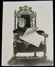 Glass Magic Lantern Slide BOY READING A NEWSPAPER IN A GRAND CHAIR C1900