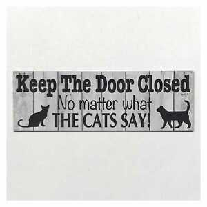 Keep The Door Closed No Matter What The Cats Say Sign
