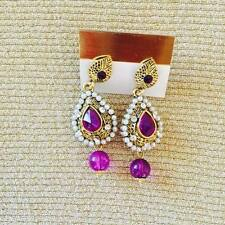 Traditional Indian earring with purple drops