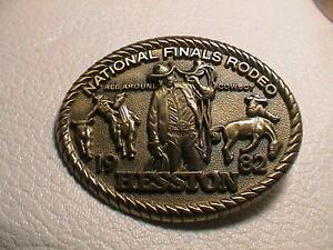 HESSTON NATIONAL FINALS 1982 BULL HORSE COWBOY WESTERN THEME BRASS BELT BUCKLE
