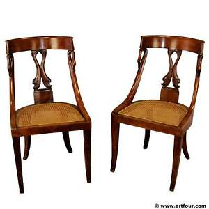 pair of hand-crafted biedermeier chairs with swan and dolphin backrests