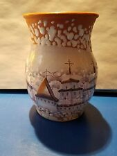 terra cotta vase with wintry Russian church scene