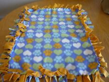 Handmade fleece tie blanket of hearts and paws for a small pet