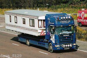 Truck Photo: A RHODES JNR CARAVAN HAULIER - SCANIA - X648 XKH - YORK Transport