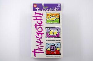 New Bandai Original Tamagotchi - Yellow & Pink 1996 - 1997 English