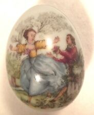 Limoges Miniature 2 Inch Porcealin Egg Gold Trim Male and Female on the Front