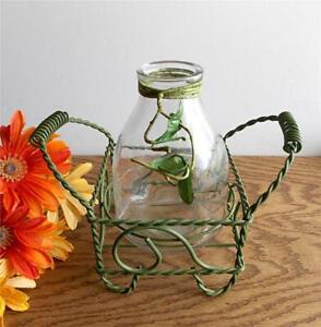 VINTAGE CLEAR GLASS BOTTLE FLOWER VASE IN A DECORATIVE GREEN TWISTED IRON FRAME