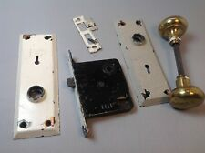 Vintage brass door knob with metal plates and locking mechanism