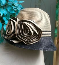 Beige and Black fancy hat with flowers