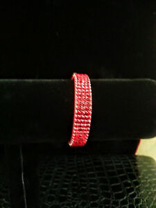 NEW  Swarovski  Crystal snap closure bracelet in a dark red color (SIAM).