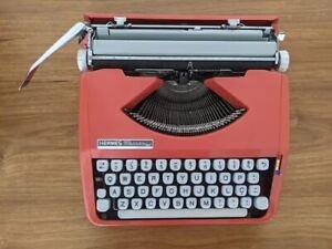 Typewriter Hermes baby orange (revised), cursive letter, Similar to Olivetti