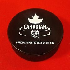 Molson Canadian - Official imported beer of the NHL Puck