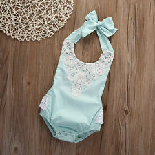 Pale blue baby romper with lace detail