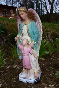 ancienne statuette religieuse polychrome archange tenant enfant