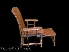 ANTIQUE FRENCH RATTAN AND BAMBOO DECK LOUNGE CHAIR WITH FOOT REST.