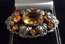 vintage amber coloured stone brooch set in silver coloured metal