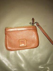 Dooney & Bourke Brown Pebble Grain Leather  Zip Top Small Wristlet.