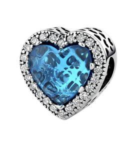 White Gold Finish Blue Topaz And Created Diamond Charm Dubai Sahara Collection
