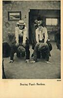 VINTAGE RATHER WEIRD GIRL'S on DAD'S BACK BEARING PAPA'S BURDENS POSTCARD UNUSED