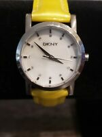 DKNY Womens Mother of Pearl Faced Watch Yellow Patent Leather Band (NY4793)